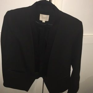 Black blazer with tuxedo lapel.